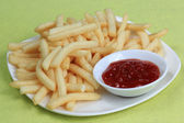 Potatoes fries with ketchup — Stock Photo