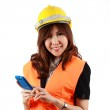 Young attractive Asian Engineer woman standing using mobile phon — Stock Photo #44923909