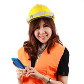 Young attractive Asian Engineer woman standing using mobile phon — Stock Photo