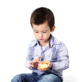 Boy eating dough nut — Stock Photo