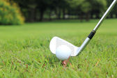 Teeing off in a game of golf — Stock Photo