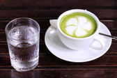 Green tea Latte with cold water — Stock Photo