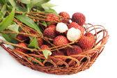 Fresh lychee fruit in basket — Stock Photo