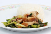 Stir fried kale Crispy pork with steamed rice  — Stock Photo