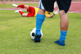 Soccer player running with ball — Stock Photo
