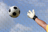 Goalkeeper's hands reaching for foot ball  — Stock Photo
