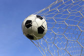 Socce in the goal net — Stockfoto