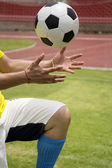 Soccer'hands reaching the foot ball — Stock Photo