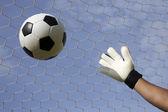 Goalkeeper's hands reaching foot ball  — Stock Photo