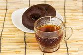 Donut e chá quente — Fotografia Stock