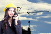 Engineer woman talking with a walkie talkie — Stock Photo