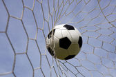 Foot ball in the goal net — Stock Photo