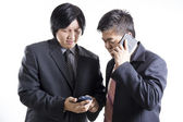 Two businessman meeting and used mobilephone — Stock Photo
