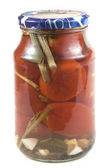 Preserved tomatoes in a jar — Stockfoto