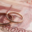 Wedding rings on money — Stock Photo