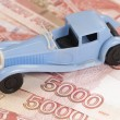 Toy car on a paper money — Stock Photo