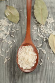 Rice in a wooden spoon — Stock Photo