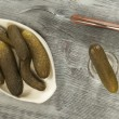 Stock Photo: Salted cucumbers and vodka