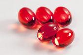 Capsule rosse — Foto Stock
