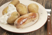 Boiled Young potatoes with sausage — Stock Photo