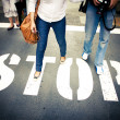 Couple At Stop Sign — Stock Photo