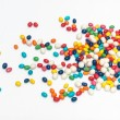 Colorful candy scattered — Stock Photo