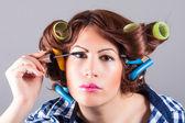 Attractive fashion model applying make up — Stock Photo