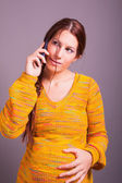 Pregnant woman talking on cell phone — Stock Photo