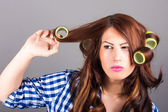 Attractive girl with curlers — Stock Photo
