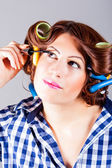 Attractive woman applying eyeliner — Stock Photo