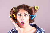 Sexy housewife with curlers — Stock Photo