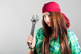 Attractive girl holding adjustable wrench — Stock Photo