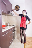 Young and pretty angry housewife — Stock Photo