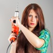 Young woman holding a power tool — Stock fotografie