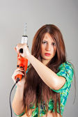 Young woman holding a power tool — Fotografia Stock