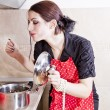 Attractive housewife in the kitchen — Stock Photo