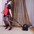 Portrait of nice housewife doing housework with vacuum cleaner — Stock Photo #36465393