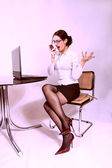 Attractive secretary with eyeglasses speaking on the phone — Stock Photo