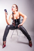 Portrait of fashion model holding a cell phone — Stock Photo