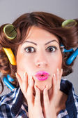Portrait of sexy housewife with curlers — Stock Photo