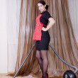 Portrait of nice housewife doing housework with vacuum cleaner — Stock Photo