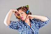 Attractive sexy housewife with curlers — Stock Photo