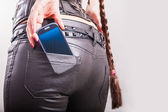 Sexy back. cell phone in back pocket — Stock Photo