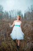 Redhead bride Tiffany in the autumn field — Stock Photo