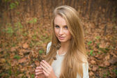 Girl with long hair in autumn forest — Stock Photo