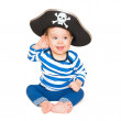 A happy young boy wearing a pirate costume. White background. — Stock Photo