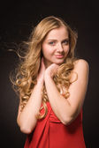 Portrait of young beautiful blonde woman in red dress — Stock Photo