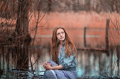 Mystical portrait of redheaded girl in the swamp — Stock Photo