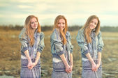 Pretty red-haired girl in the image of twin sisters — Stock Photo