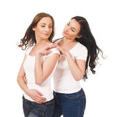 Studio shot portrait on isolated background of two sisters twin — Stock Photo